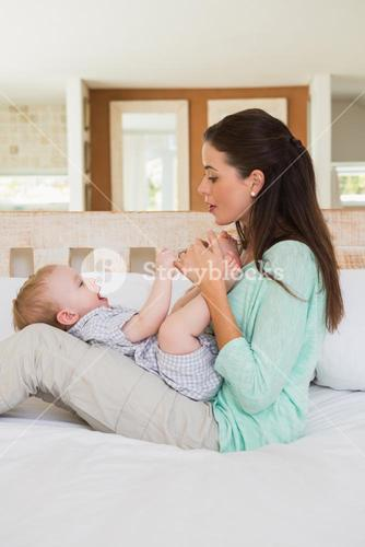 Happy mother with her baby boy