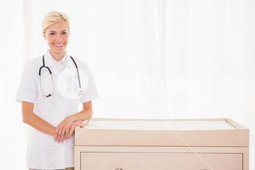 Portrait of a smiling blonde doctor with stethoscope