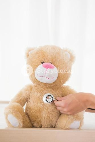 Teddy bear with doctor and stethoscope