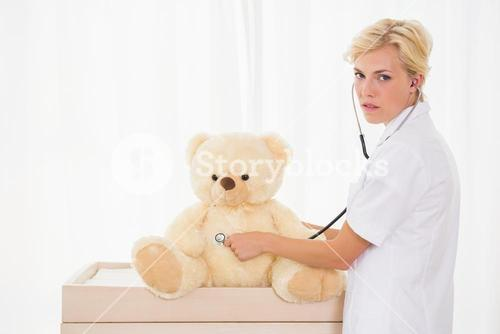 Blonde doctor with bear and stethoscope