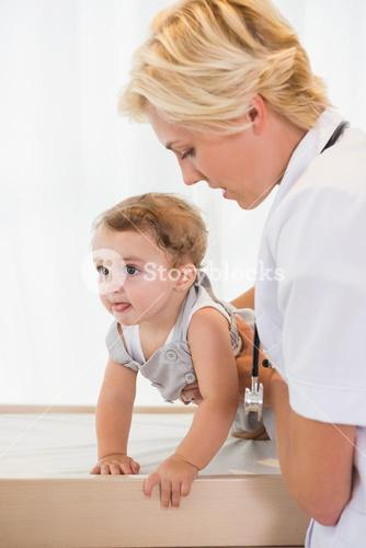 Blonde doctor with a child and stethoscope