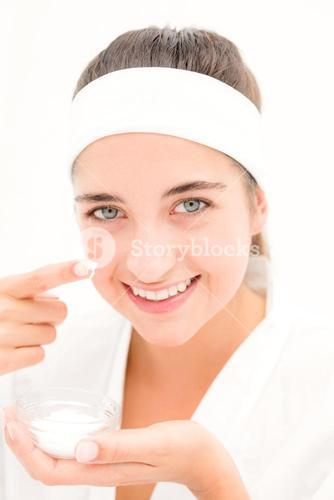 Beautiful smiling woman mid section of woman applying cream
