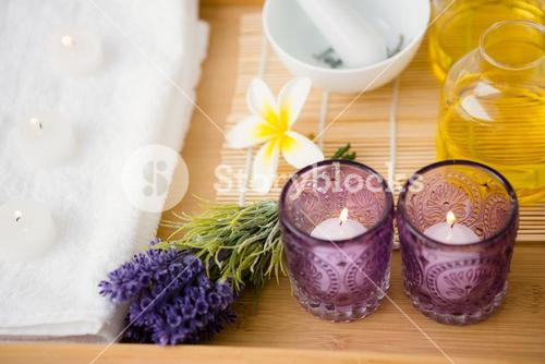 Massage tray with candles and oil