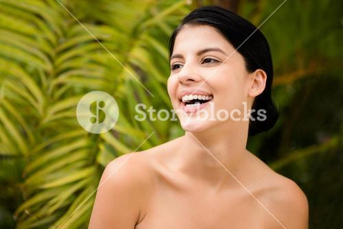 Laughing woman preparing herself for spa day
