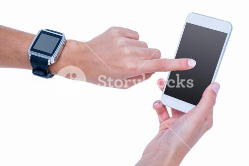 Close up of woman using her smartphone and wearing smartwatch