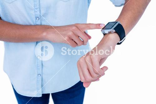 Close up of woman using her smartwatch