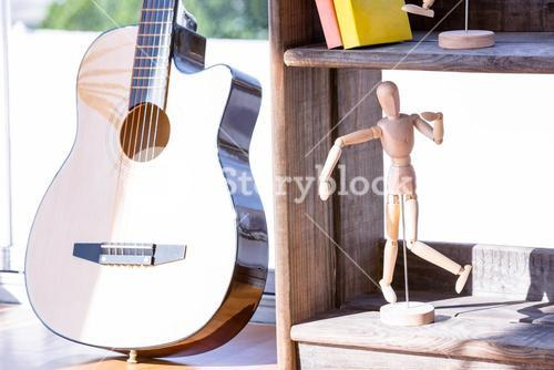 Close up of mannequin and guitar
