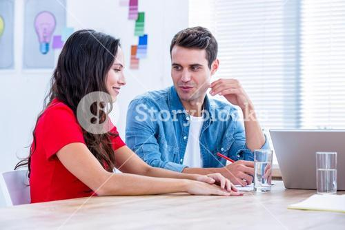 Creative business talking together in meeting
