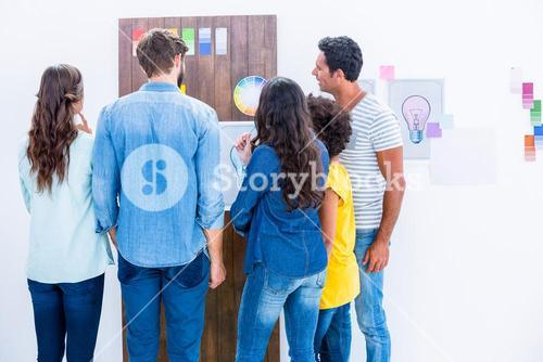 Creative team looking at color sample