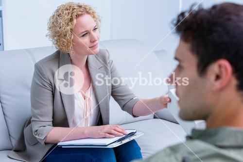 Businesswoman giving paper tissue to her colleague