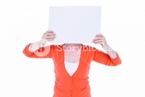 Woman hiding his head with blank paper