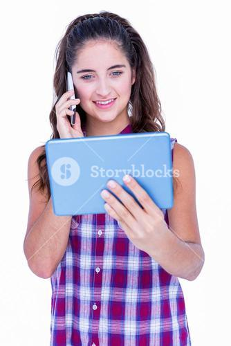 Happy pretty brunette using tablet computer and having phone call