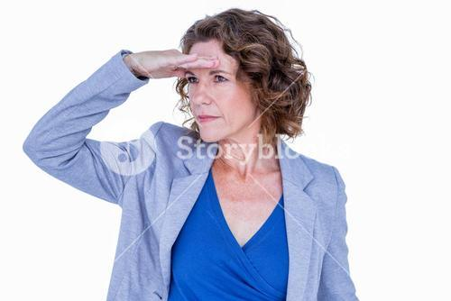 Businesswoman looking away with hand on forehead