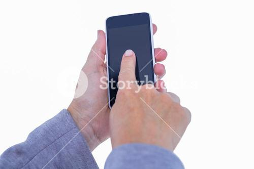 Hand of woman touching smartphone