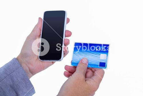 Hands of woman holding smartphone and credit card