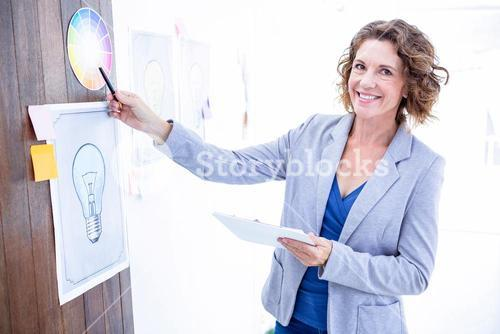 Creative businesswoman pointing color sample