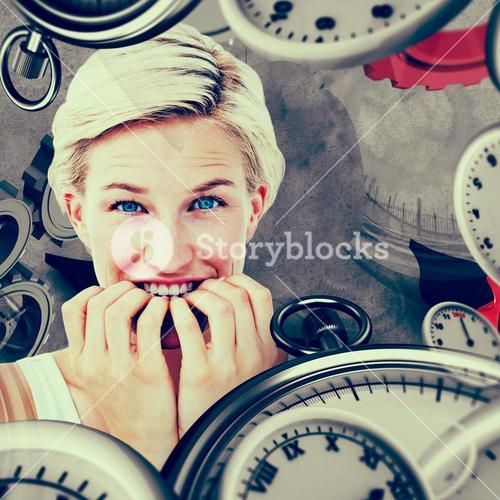 Composite image of nervous woman biting her nails looking at camera
