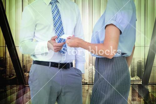 Composite image of business people exchanging business card
