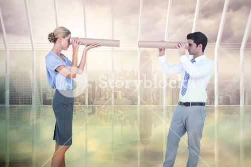 Composite image of business people looking at each other
