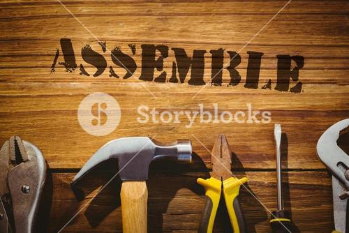 Assemble against desk with tools