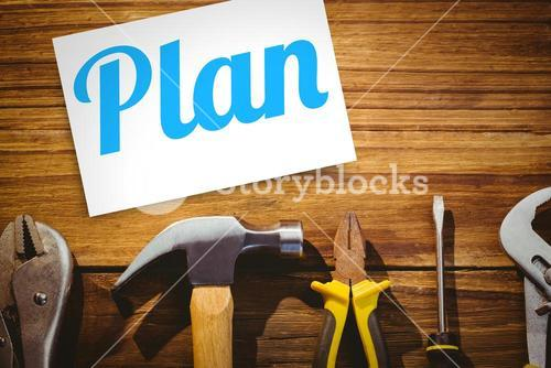 Plan against desk with tools