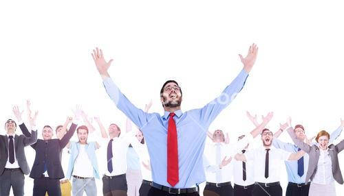 Composite image of happy cheering businessman raising his arms