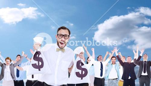 Composite image of geeky businessman holding money bags