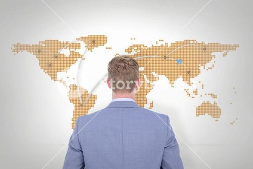 Composite image of a back turned businessman on a background
