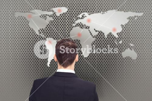 Composite image of rear view of businessman in suit standing