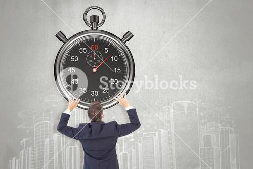 Composite image of businessman climbing on a cube with arms out