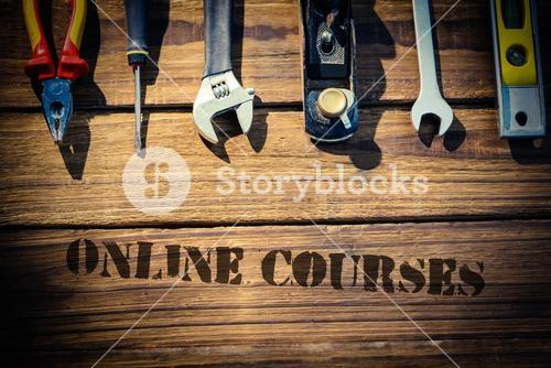 Online courses against desk with tools