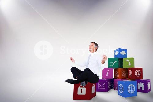 Composite image of peaceful businessman sitting in lotus pose