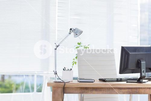 Computer and notebook on the desk