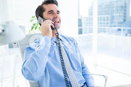 Smiling businessman phoning