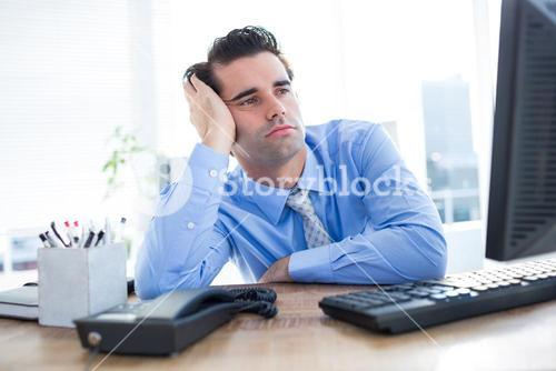 Businessman looking at computer monitor in office