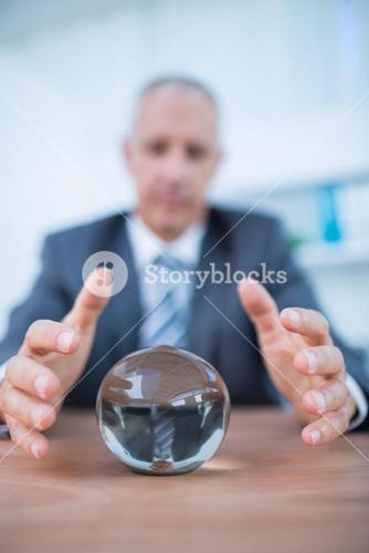 Businessman forecasting a crystal ball