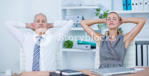 Business people relaxing in swivel chairs