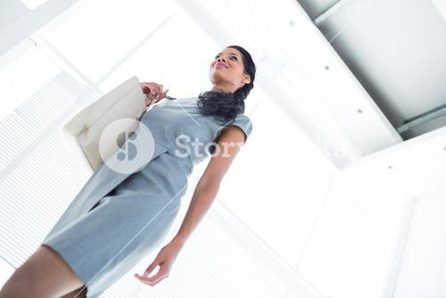Smiling businesswoman leaving the office