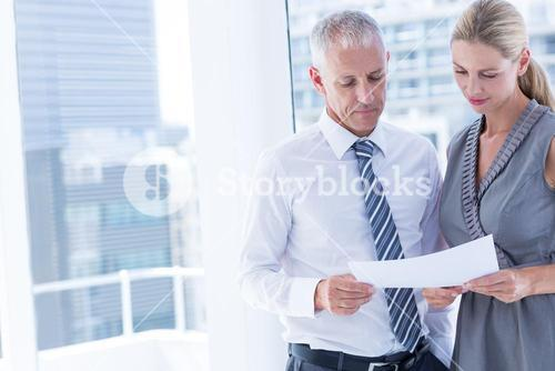 Business people talking over a paper sheet