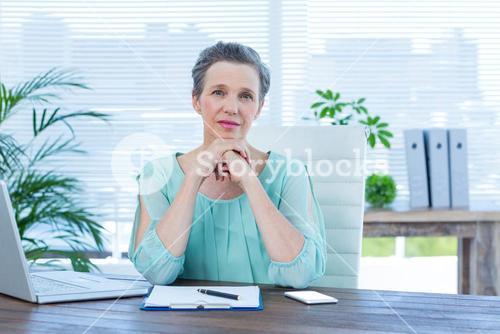 Attentive businesswoman looking at the camera