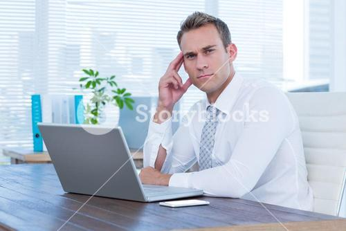 Focused businessman looking at the camera