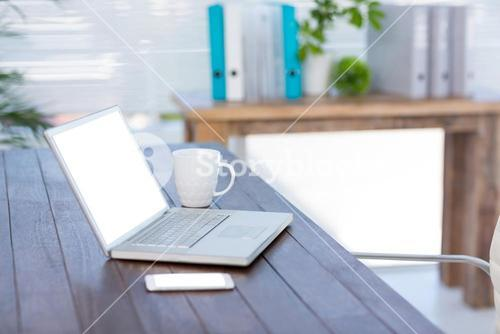 Business desk with laptop and smartphone