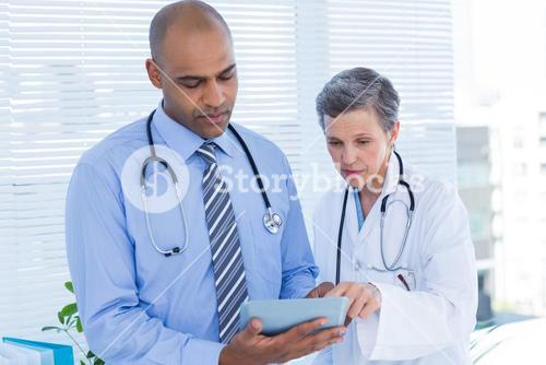 Medical colleagues working with tablet computer