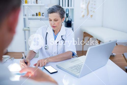 Female doctor speaking with her patient