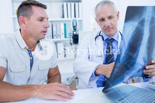 Doctor and patient looking at Xray