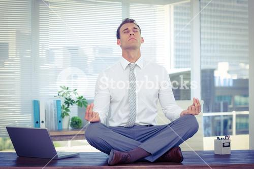 Zen businessman doing yoga meditation