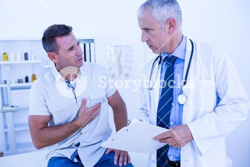 Serious doctor speaking with his patient