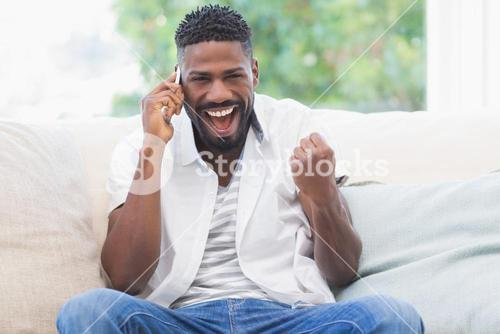 Excited man on the phone