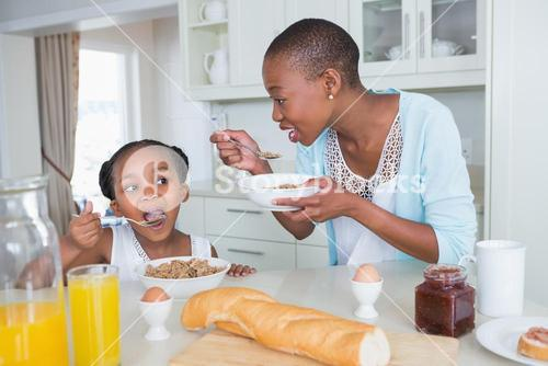 Mother and duaghter eating together