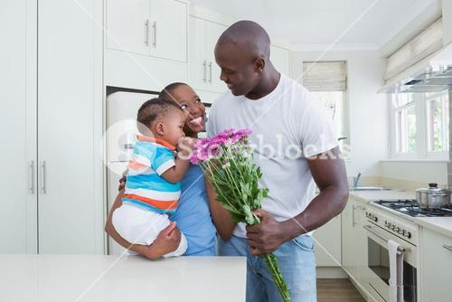 Happy smiling couple with his babyboy